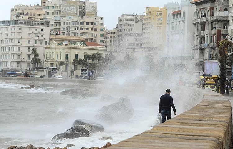 Stormy weather hits the Egyptian port city of Alexandria in January 2018. Police in the city are detaining two journalists for allegedly filming without a license. (AFP/Stringer)