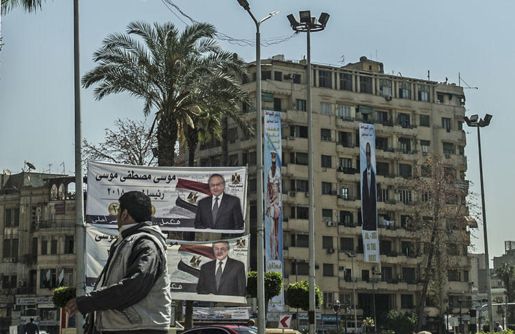 Presidential election campaign banners in downtown Cairo on March 7, 2018. At least four journalists have been detained since President Abdel Fattah el-Sisi declared his re-election bid. (AFP/Khaled Desouki)