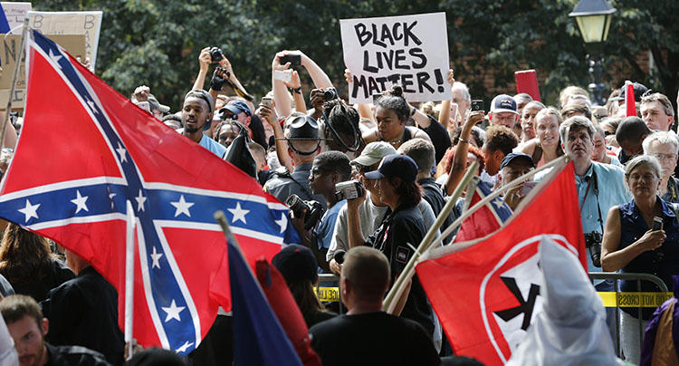 Protesters demonstrate against a KKK rally in Charlottesville, VA, in July 2017. Journalists reporting on white supremacists say they face threats and harassment. (AP/Steve Helber)