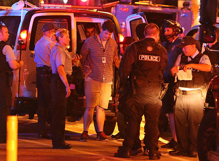 Police arrest St. Louis Post-Dispatch reporter Mike Faulk in September 2017. Faulk is one of at least 10 journalists detained in the city late last year when police used the tactic of kettling during protests. (David Carson/St. Louis Post-Dispatch)