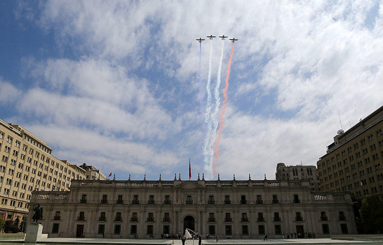 Airplanes fly in formation in Santiago, Chile on March 3, 2017. The independent Santiago-based Center for Investigative Journalism on March 7 reported that Chilean police intercepted calls, as well as WhatsApp and Telegrammessages, between five journalists and their sources. (Reuters/Ivan Alvarado)