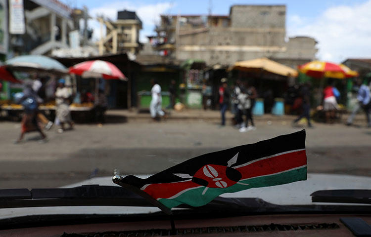 A Kenyan flag inside a car in the capital Nairobi, Kenya, October 29, 2017. According reports, police officers attacked reporters at the Jomo Kenyatta International Airport in Nairobi while they were covering an opposition politician's return to the country. (Reuters/Siegfried Modola)