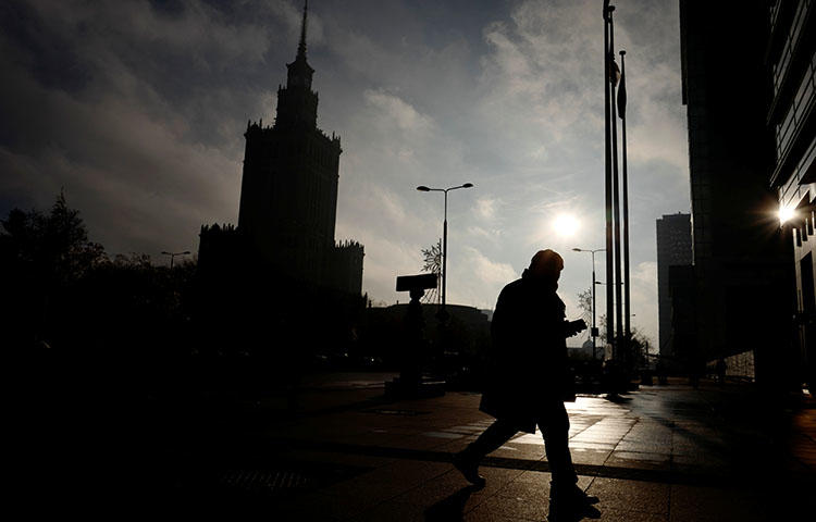 A man walks near the Palace of Culture and Science in the morning in Warsaw, Poland in November 2017. (Reuters/Kacper Pempel)