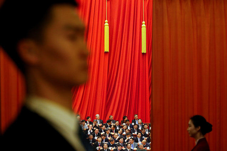 Delegates attend a plenary session of the Chinese People's Political Consultative Conference in Beijing in March 2018. Police in the city briefly detained a RFI reporter who was interviewing people about a vote on China's constitutional reform. (Reuters/Thomas Peter)