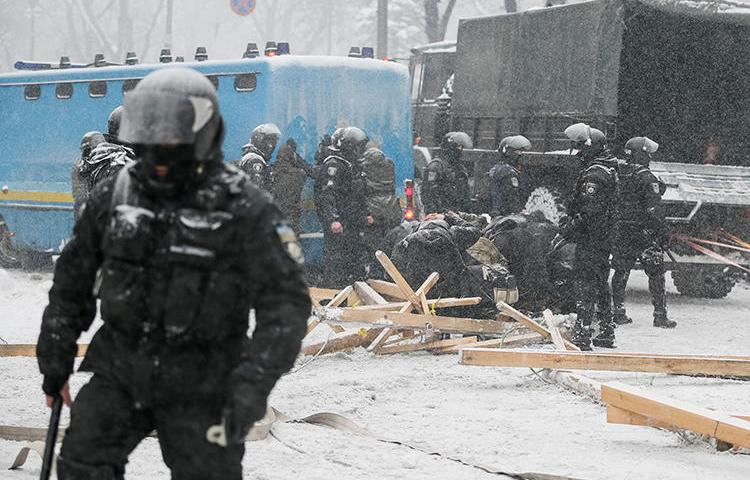 Police detain protesters while the National Guard removes a camp near the parliament building in Kiev on March 3. At least two journalists were injured while covering the unrest. (Reuters/Gleb Garanich)