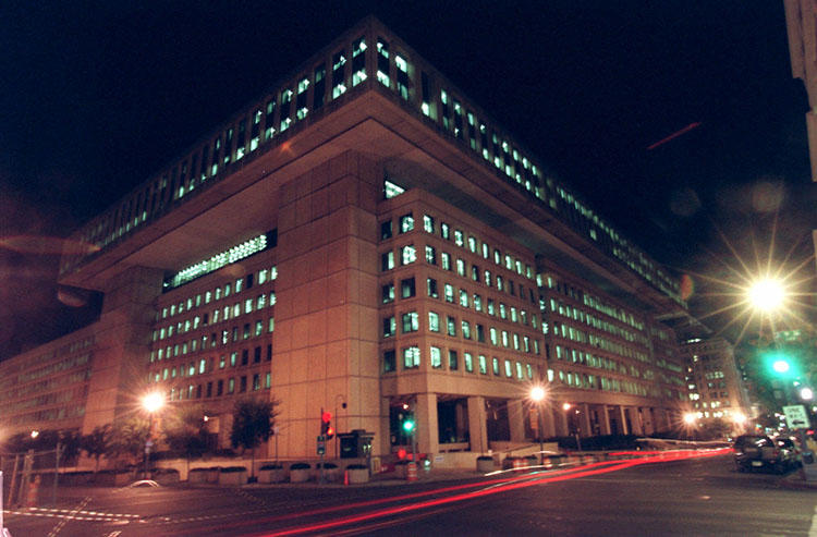 The US Department of Justice uses the Espionage Act to charge an agent of the Federal Bureau of Investigation, whose Washington D.C. headquarters are pictured, for allegedly leaking information to a reporter (AP/Pablo Martinez Monsivais).