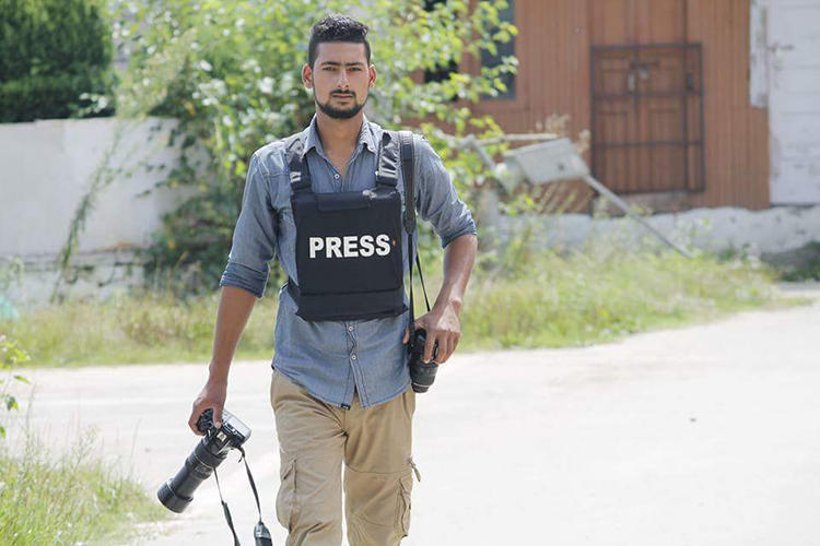 Photojournalist Kamran Yousuf, pictured, is facing charges after covering unrest in Jammu and Kashmir state. (Younis Khaliq)