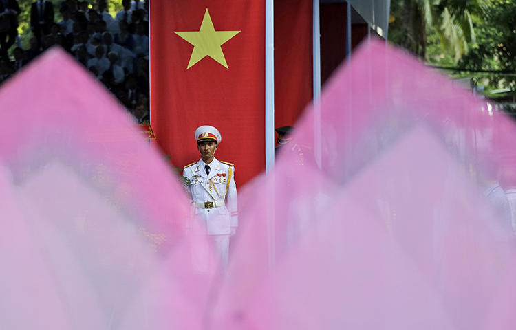 An honor guard stands at attention in Ho Chi Minh City, Vietnam, in April 2015. Plainclothes officials in Hanoi on February 24, 2018, interrogated Pham Doan Trang, an independent blogger and contributor to the Vietnam Right Now independent news website, and effectively put her under house arrest, prompting the blogger to flee, according to news reports. (AP/Dita Alangkara)