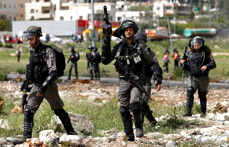 Israeli border police officers during clashes with Palestinians in the occupied West Bank on April 13, 2018. A Palestinian photographer Ahmed Abu Hussein died on April 25 from bullet wounds to his abdomen sustained on April 13 while he was covering protests in Gaza, according to reports. (Reuters/Mohamad Torokman)