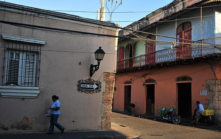 A woman walks in Santo Domingo in 2008. A Dominican court has sentenced a man to 20 years in prison over the murder of a journalist. (AFP/Eitan Abramovich)