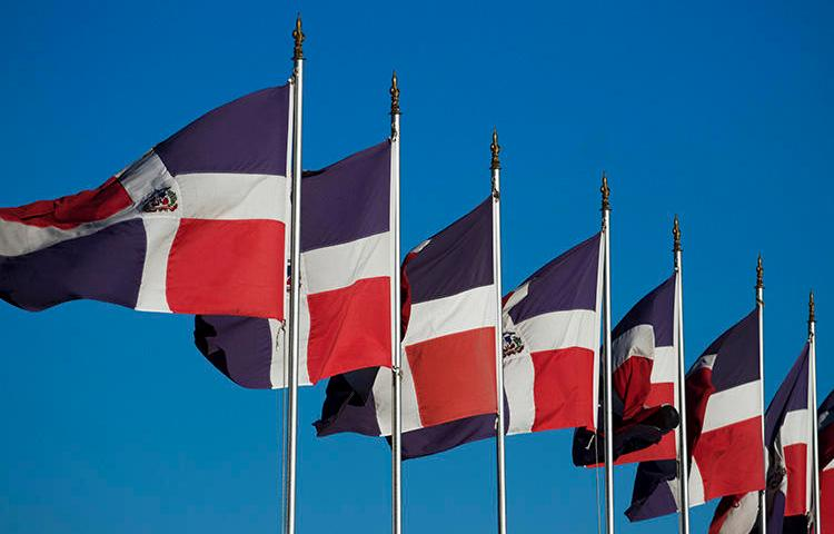 Dominican flags in Santo Domingo in 2012. A Noticias SIN reporter says threats were made against her after she reported on the murder of a fellow journalist. (AFP/Erika Santelices)