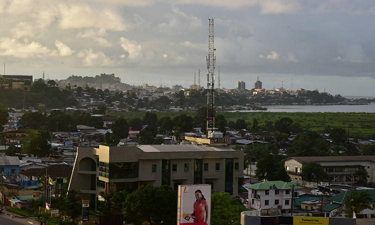 A view of Liberia's capital, Monrovia, in October 2017. Police are investigating the death of a journalist found stabbed outside his home in the city. (AFP/Issouf Sanogo)
