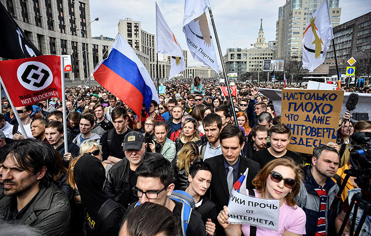 Protesters at an opposition rally in Moscow on April 30 demand internet freedom in Russia amid a crackdown on the app, Telegram. (AFP/Alexander Nemenov)