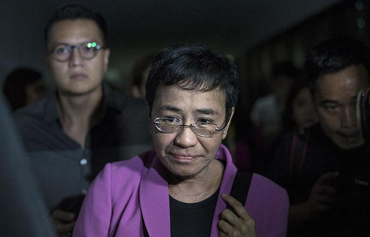 Maria Ressa, the founder of Rappler, arrives at the National Bureau of Investigation headquarters in Manila on January 22, 2018. Ressa says she believes the news website is being harassed because of its critical coverage of the President of the Philippines. (AFP/Noel Celis)