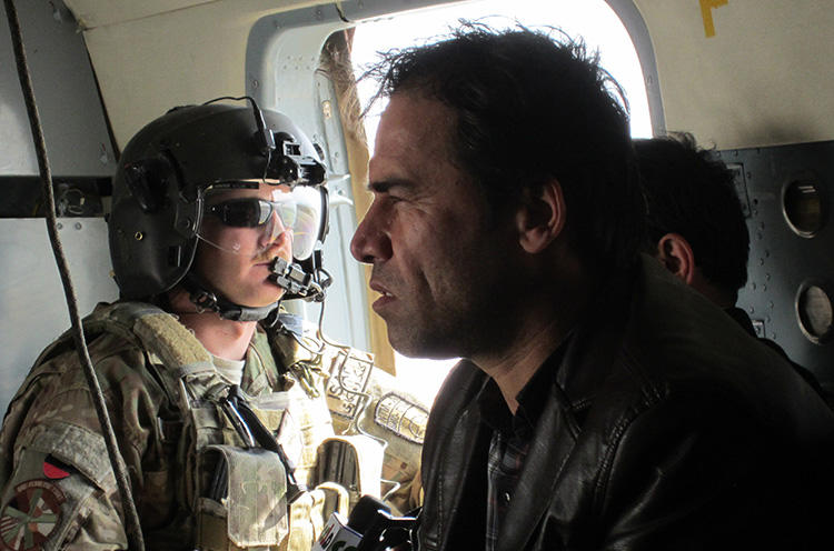 AFP chief photographer Shah Marai, pictured while on assignment in 2013, is one of at least nine journalists killed in a suicide bombing in Kabul on April 30. (AFP/Ben Sheppard)