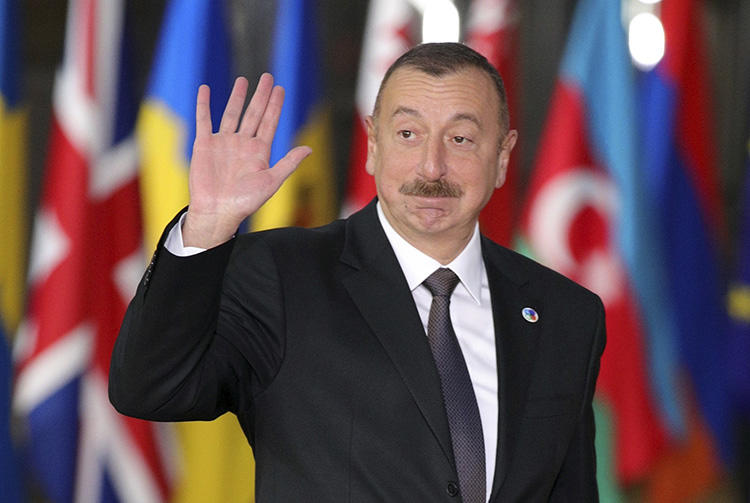 Azerbaijan's President Ilham Aliyev arrives in Brussels in November 2017. Azerbaijan has continued to harass and censor its press ahead of snap elections scheduled for April 11. (AP/Olivier Matthys/File)