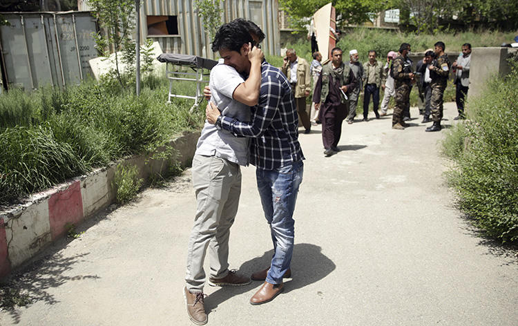 Journalists mourn for their colleagues who were killed in a suicide bombing in Kabul on April 30, 2018 that killed at least nine members of the press. (AP/Massoud Hossaini)