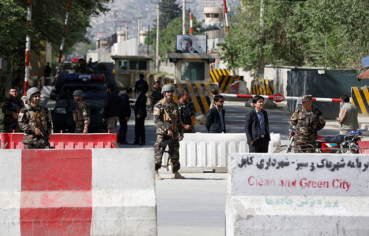 Afghan security forces stand guard near the site of a blast in Kabul, Afghanistan on April 30, 2018. At least 25 people were killed, including eight journalists, in double suicide bombing attack in Kabul on April 30, 2018, according to reports. (Reuters/Omar Sobhan)