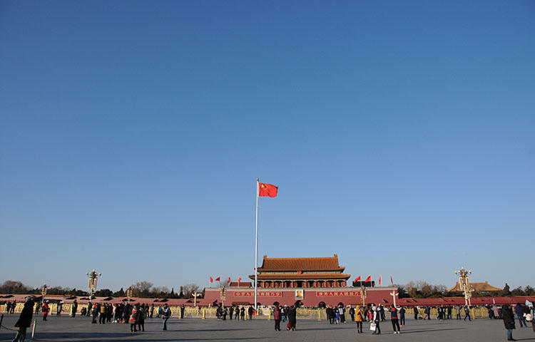 A Chinese flag flutters in Tiananmen Square in Beijing, China in December 2017. Police from Inner Mongolia arrested journalist Zou Guangxiang at his Beijing home on March 28, 2018, according to news reports. (Reuters/ Stringer)