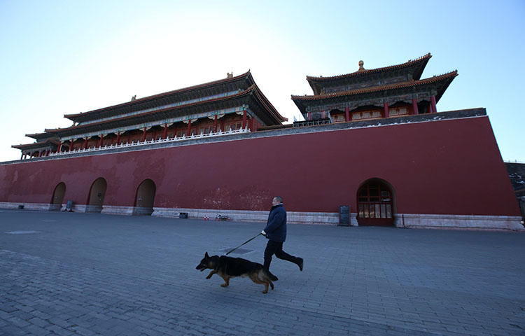 Canine patrol security staff run during a daily training session at the Forbidden City in central Beijing, China in February 2018. Chinese authorities released freelance journalist Qi Chonghuai from prison in Shandong province on February 13, 2018, after he served over 10 years, according to reports. (Reuters/Jason Lee)