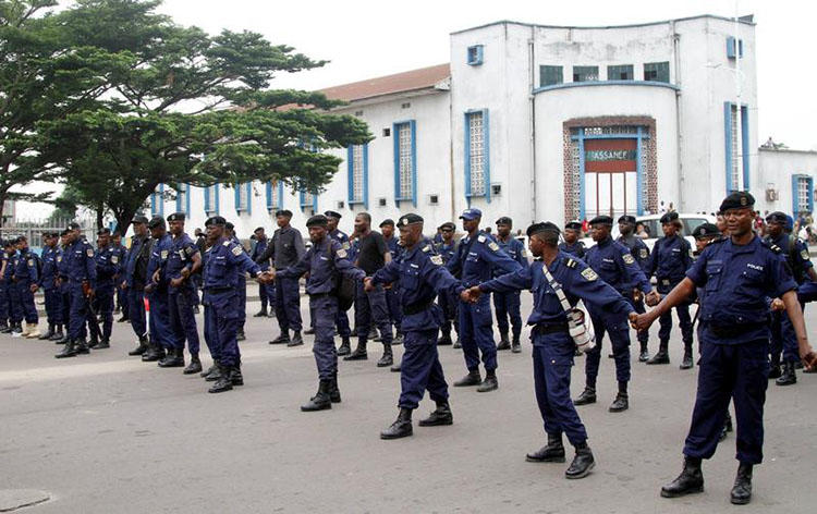 Riot police prepare ahead of civilian protests in Kinshasa. Journalists covering unrest in the DRC risk being detained, attacked, or harassed. (Reuters/Kenny Katombe)