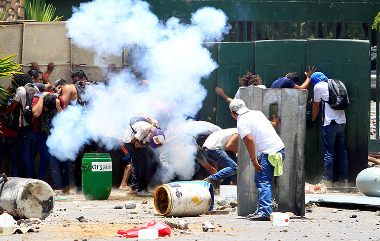 Students clash with police during protests in Managua on April 19, over planned reforms to Nicaragua's social security system. (Reuters/Oswaldo Rivas)