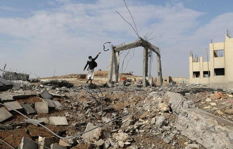 A man walks through the rubble of an airstrike in Saada, Yemen on April 12. One journalist was killed and three others were injured in a missile attack in the country's Bayda province. (Reuters/Naif Rahma)