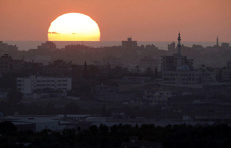 The sun sets over the Gaza Strip on May 14, 2018. Seven Palestinian journalists were injured by gunfire in Gaza protests on May 14, according to reports. (Reuters/Amir Cohen)