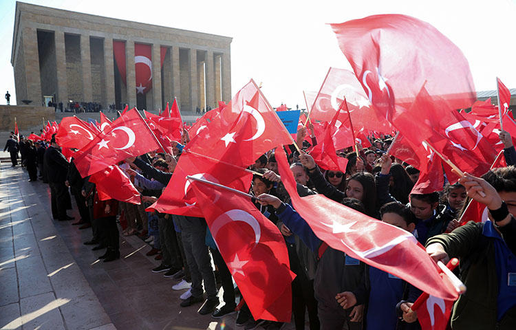 Children wave the Turkish flag outside the mausoleum of the founder of the Turkish Republic Mustafa Kemal Ataturk, in Ankara on April 23, 2018. A Turkish government minister in December 2017 said that Turkey blocked Wikipedia because it insults Mustafa Kemal Atatürk, the founder of modern Turkey, according to reports. (AFP/Adem Altan)
