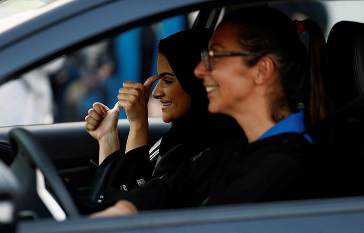 A Saudi woman gestures as she sits in a car during a driving class at a university in Jeddah, Saudi Arabia on March 7, 2018. Saudi security forces detained blogger Eman Al Nafjan alongside six other people associated with the women's rights movement who have campaigned for an end to the ban on women driving, according to reports. (Reuters/Faisal Al Nasser)