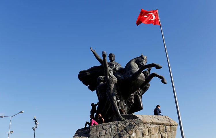 "The Republic monument in Antalya, Turkey in March 2018. Turkish authorities detained for several hours on May 28 journalist Ali Ergin Demirhan on suspicion that he made ""propaganda for a [terrorist] organization,"" according to reports. (Reuters/Murad Sezer)"