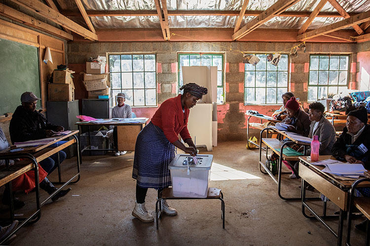 A woman casts her ballot in general elections at a polling station in the village of Nyakosoba, Lesotho, on June 3, 2017. Lesotho's Constitutional Court declared criminal defamation unconstitutional on May 21, 2018. (Gianluigi Guercia/AFP)