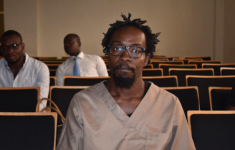 Cartoonist Ramón Nsé Esono Ebalé, pictured in court in February 2018. The journalist was acquitted and released from jail but authorities in Equatorial Guinea have not renewed his passport, which means Esono Ebalé cannot return to El Salvador. (AFP/Samuel Obiang)
