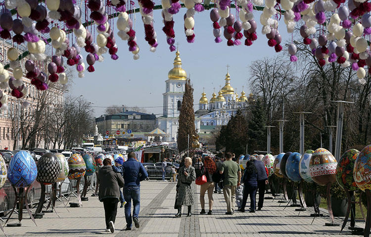 People visit an art installation of Easter eggs, in Kiev, Ukraine on April 10, 2018. Vladislav Pleshakov, a journalist from the privately owned television channel 1+1, was assaulted in an upscale neighborhood near Kiev on April 21, 2018, while filming for an investigative report, according to reports. (AP/Efrem Lukatsky)