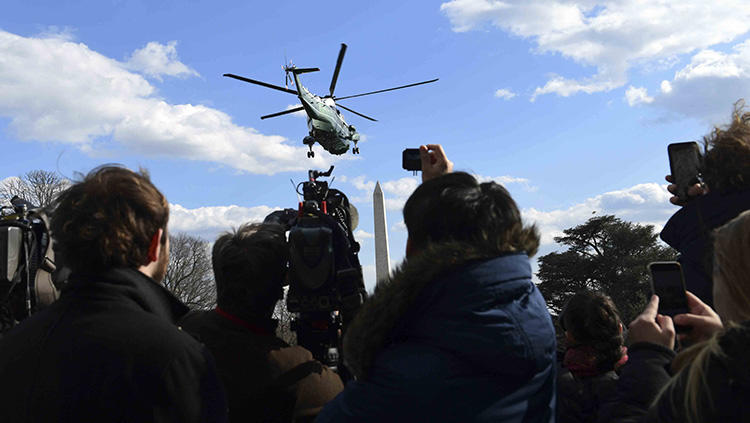 Journalists watch as Marine One, with President Donald Trump on board, lifts off from the White House in March 2018. An already hostile environment for the U.S. press has worsened since Trump came to power. (AP/Susan Walsh)