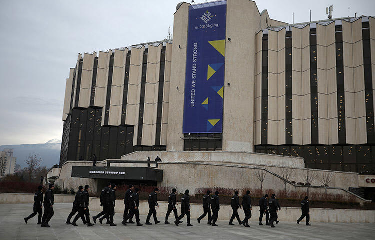 Police patrol outside the National Palace of Culture during a ceremony starting Bulgaria's six-month presidency of the European Union in Sofia, Bulgaria, January 12, 2018. (Reuters/Stoyan Nenov)