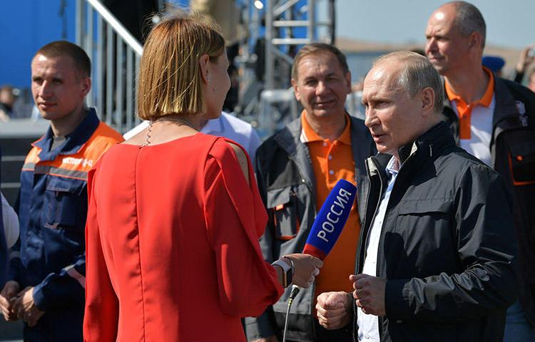 Russian President Vladimir Putin gives an interview at a May 15, 2018, ceremony opening a bridge that will connect the Russian mainland with the Crimean Peninsula. Ukraine authorities accused the director of Russian state news agency RIA Novosti's Kiev office of propaganda supporting the annexing of Crimea. (Sputnik/Alexei Druzhinin/Kremlin via Reuters)