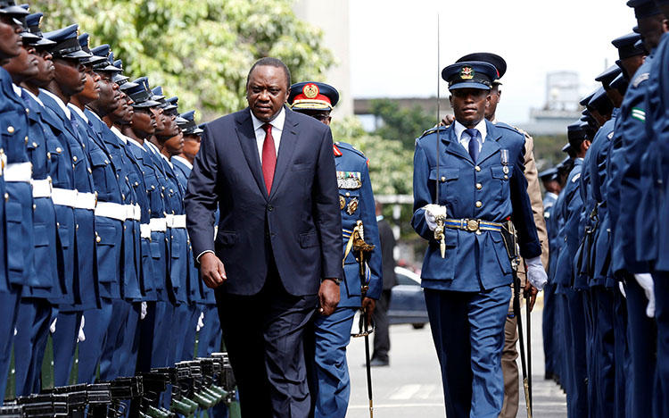 Kenyan President Uhuru Kenyatta inspects an honor guard in Nairobi on May 2, 2018. CPJ calls on Kenyatta not to sign a cybercrime bill passed by Parliament. (Reuters/Thomas Mukoya)
