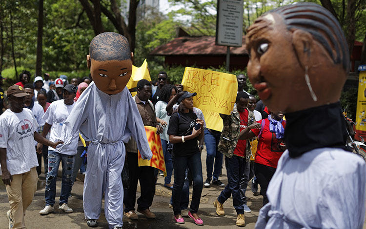 Protesters march against government corruption in Nairobi on the 53rd anniversary of Kenya's independence on December 12, 2016. Kenyan authorities arrested blogger Cyprian Nyakundi on May 14, 2018, after his posts on alleged official corruption, and released him three days later. (AP/Ben Curtis)