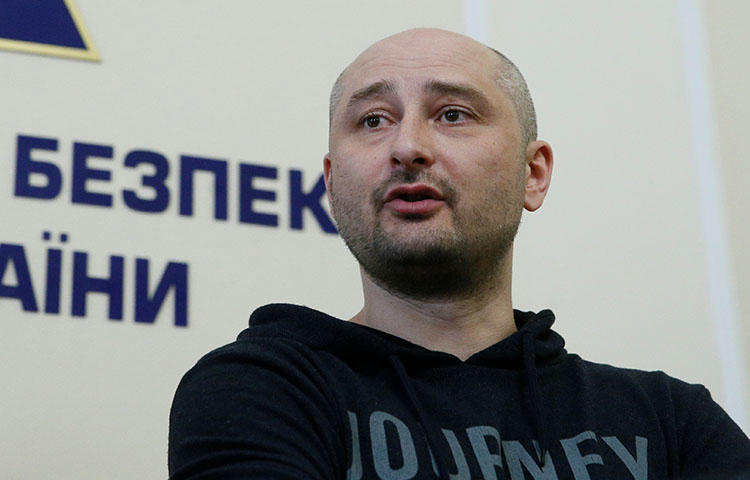 Russian journalist Arkady Babchenko, who was reported killed in the Ukrainian capital on May 29, 2018, speaks during a Ukrainian state security service press briefing in Kiev on May 30, 2018, where authorities announced the staging of his assassination. (Reuters/Valentyn Ogirenko)