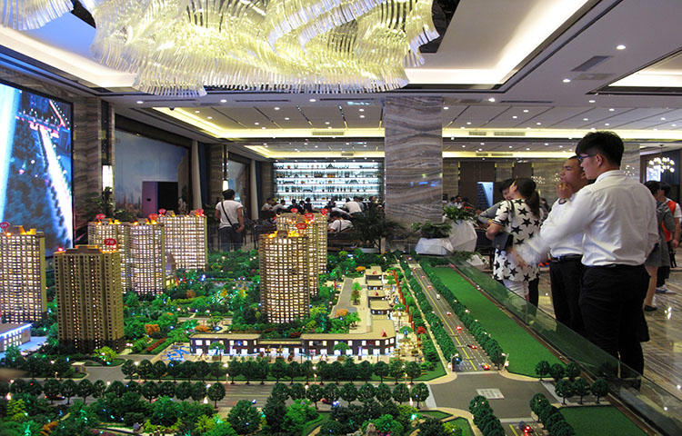 Models of residential buildings at a sales center in Henan province, China in September 2016. A television crew was assaulted in Kaifeng City in Henan province while reporting on a real estate dispute, according to reports. (Reuters/Yawen Chen)