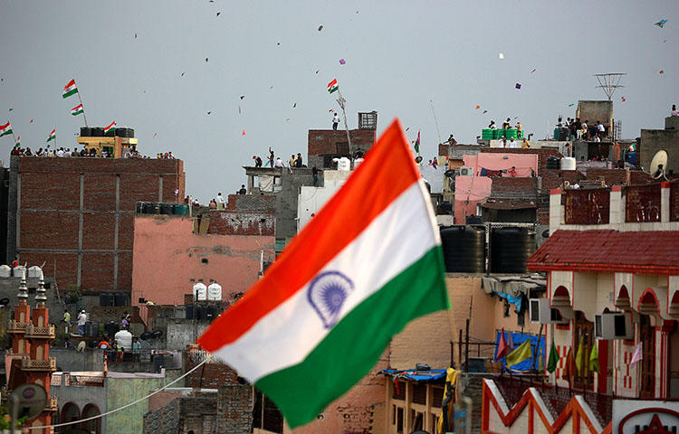 An Indian flag flies in Delhi on the country's Independence Day, August 15, 2017. The Delhi High Court on May 24, 2018, issued an injunction that forbids the screening of Operation 136: Part II, a documentary that alleges more than 24 media organizations were willing to publish advantageous stories for payment, according to reports. (Reuters/Cathal McNaughton)