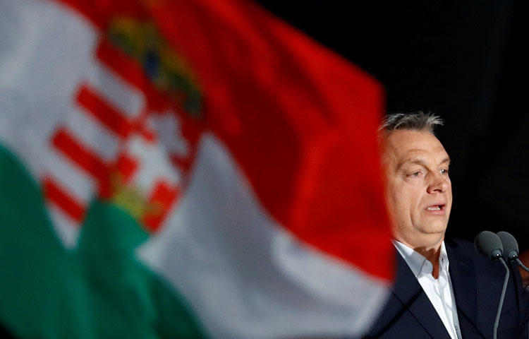 Hungarian Prime Minister Viktor Orbán addresses supporters in Budapest after partial results of the country's parliamentary elections are announced on April 8, 2018. (Reuters/Leonhard Foeger)