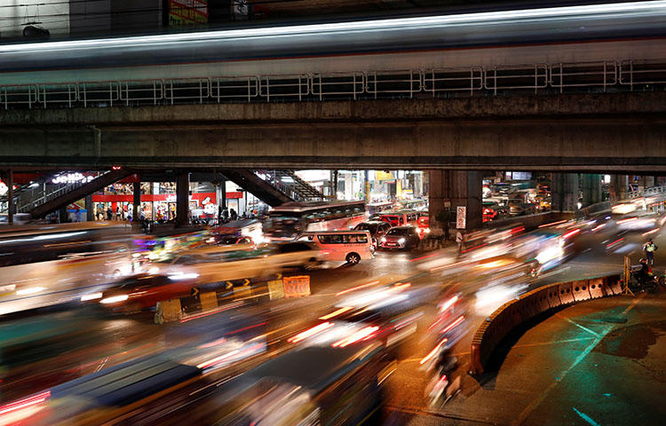 A main thoroughfare during rush hour in Quezon City, Philippines in February 2018. A Filipino journalist died on May 2, 2018, from injuries sustained in a shooting attack on April 30 in Dumaguete City. (Reuters/Dondi Tawatao)