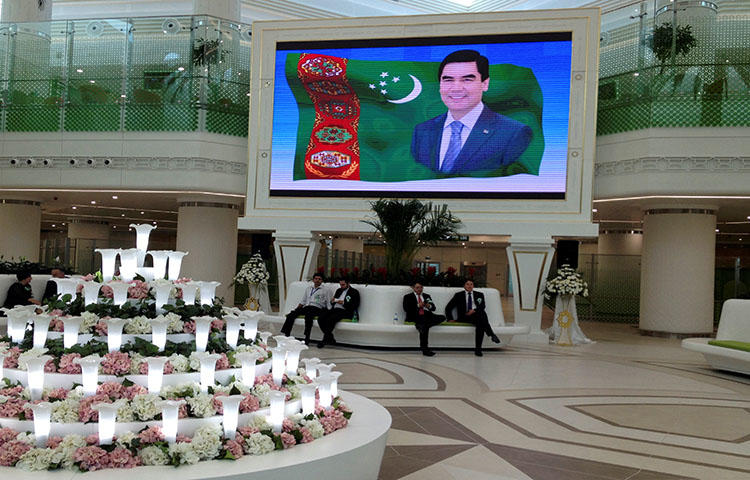 An airport in Ashgabat features a portrait of Turkmen President Kurbanguly Berdymukhamedov in September 2016. Turkmen authorities threatened and detained journalist Soltan Achilova on May 9, 2018, as she was attempting to take pictures. (Reuters/Marat Gurt)