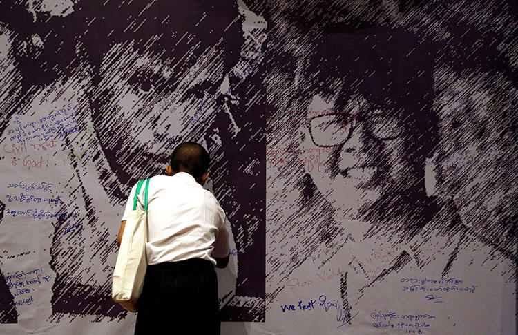 Messages of support are left on a poster depicting detained Reuters reporters Wa Lone and Kyaw Soe Oo, at a press freedom event in Yangon, Myanmar, on May 1. (Reuters/Ann Wang)