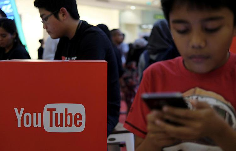 People attend the YouTube Fanfest in Jakarta, Indonesia, in October 2016. Google released its first YouTube-specific transparency report in May. (Reuters/Beawiharta)