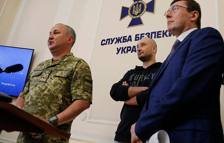 Vasily Gritsak, head of the Ukrainian Security Service, left, speaks to the media as Russian journalist Arkady Babchenko, center, and Ukrainian Prosecutor General Yuriy Lutsenko attend a news conference at the Ukrainian Security Service on May 30, 2018. Babchenko turned up at a news conference in the Ukrainian capital Wednesday less than 24 hours after police reported he had been shot and killed in Kiev. (AP/Efrem Lukatsky)