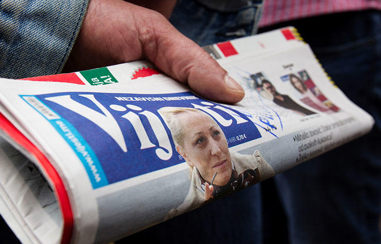 The daily Vijesti with a picture of attacked Montenegrin investigative reporter Olivera Lakic on May 9, 2018. (Reuters/Stevo Vasiljevic)