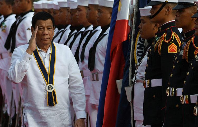 President Rodrigo Duterte, pictured in Manila in May 2018, says he wants all media killings solved by 2020. In the latest attack, a newspaper publisher was shot dead in Panabo City in June. (AFP/Ted Aljibe)